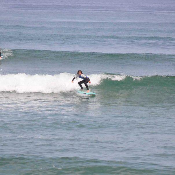 niña surf los locos surf school suances cantabria